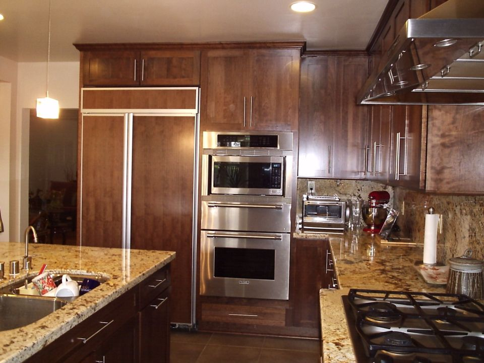 Cherry Cabinets With Shaker Style And Granite Tops