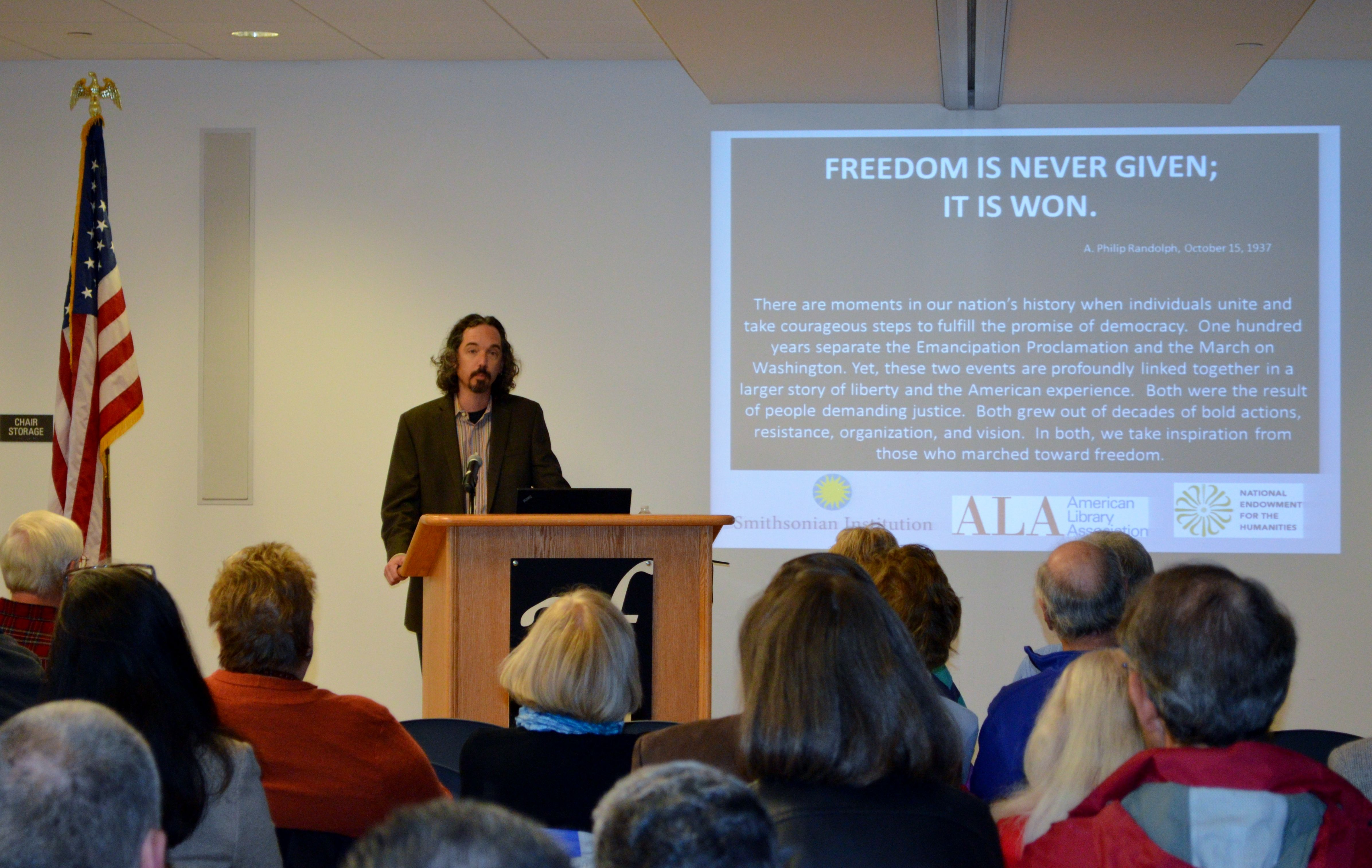 Glenn Grube Director Of The Avon Public Library Addresses The Audience At The Changing America Exhibit Series Openi The Proclamation Public Library America