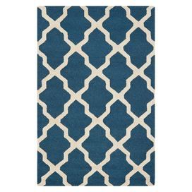Wool rug with a navy blue and ivory trellis motif. Hand-tufted in India.