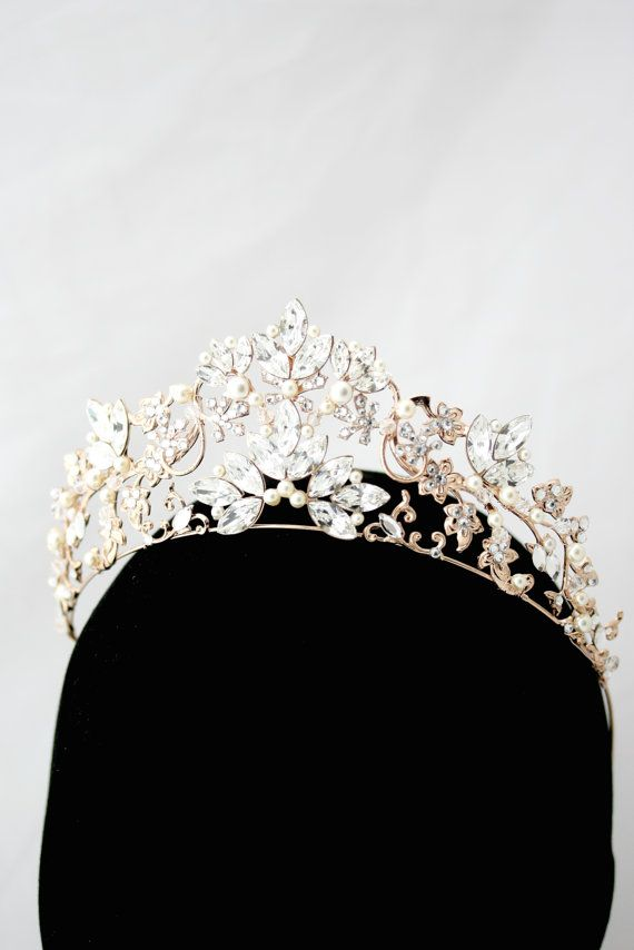 A stunning Handmade Wedding Tiara that dazzles with beauty. This Premium show stopping headpiece is a unique Lulu Splendor Design made specifically for Bridal wear. Fully handmade using detailed vintage stampings and settings, soldered into a delicate sweeping shape to accentuate your hair style. Trimmed in full Swarovski Crystal Rhinestone (they really shine!) and pearl (or full crystal if you prefer) This piece slides on you head and stays in place perfectly. Lulu Splendor Hair accessories ... #crowntiara
