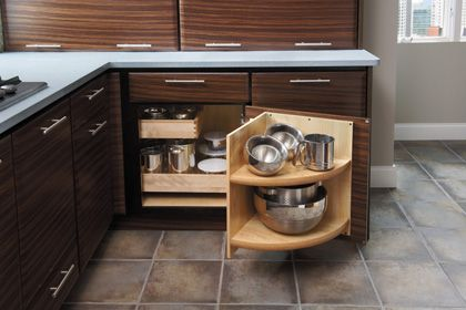 Starmark cabinetry blind corner with roll out trays and for Corner kitchen cabinet storage ideas