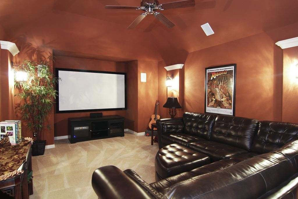 Media Room Neutral Carpeting Custom Paint Ceiling Fan Wall