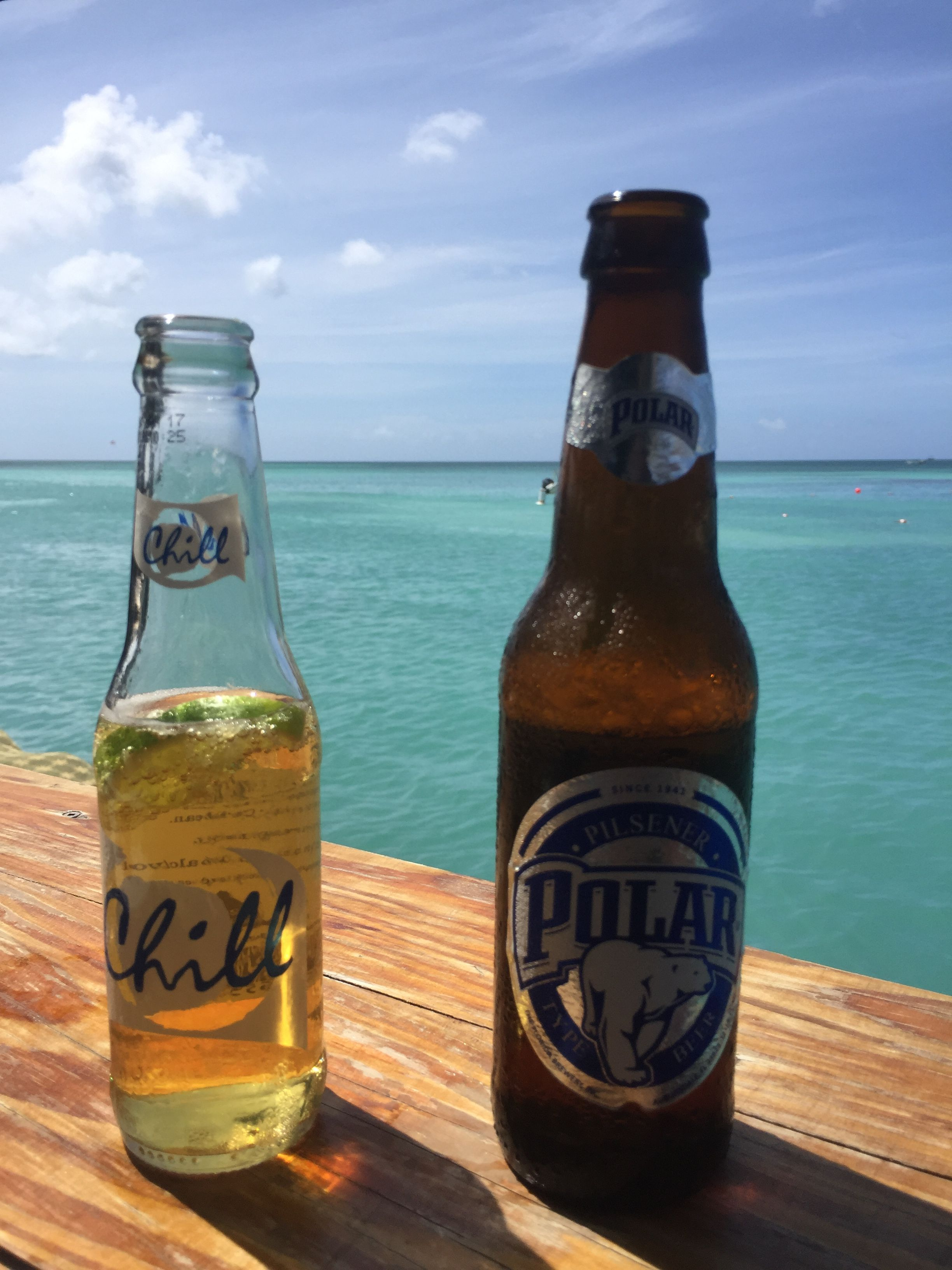 Two Beers You Can Only Get In Aruba Great Little Bar On The Ocean Parasailing Windsurfing Aruba