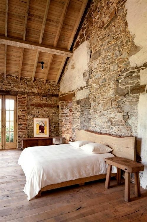 Interior, : Cozy Rustic Bedroom Decoration Using Rustic Stone Wall Paneling  Style Along With Solid Wood Bedroom Flooring And Wood Slab Headboard