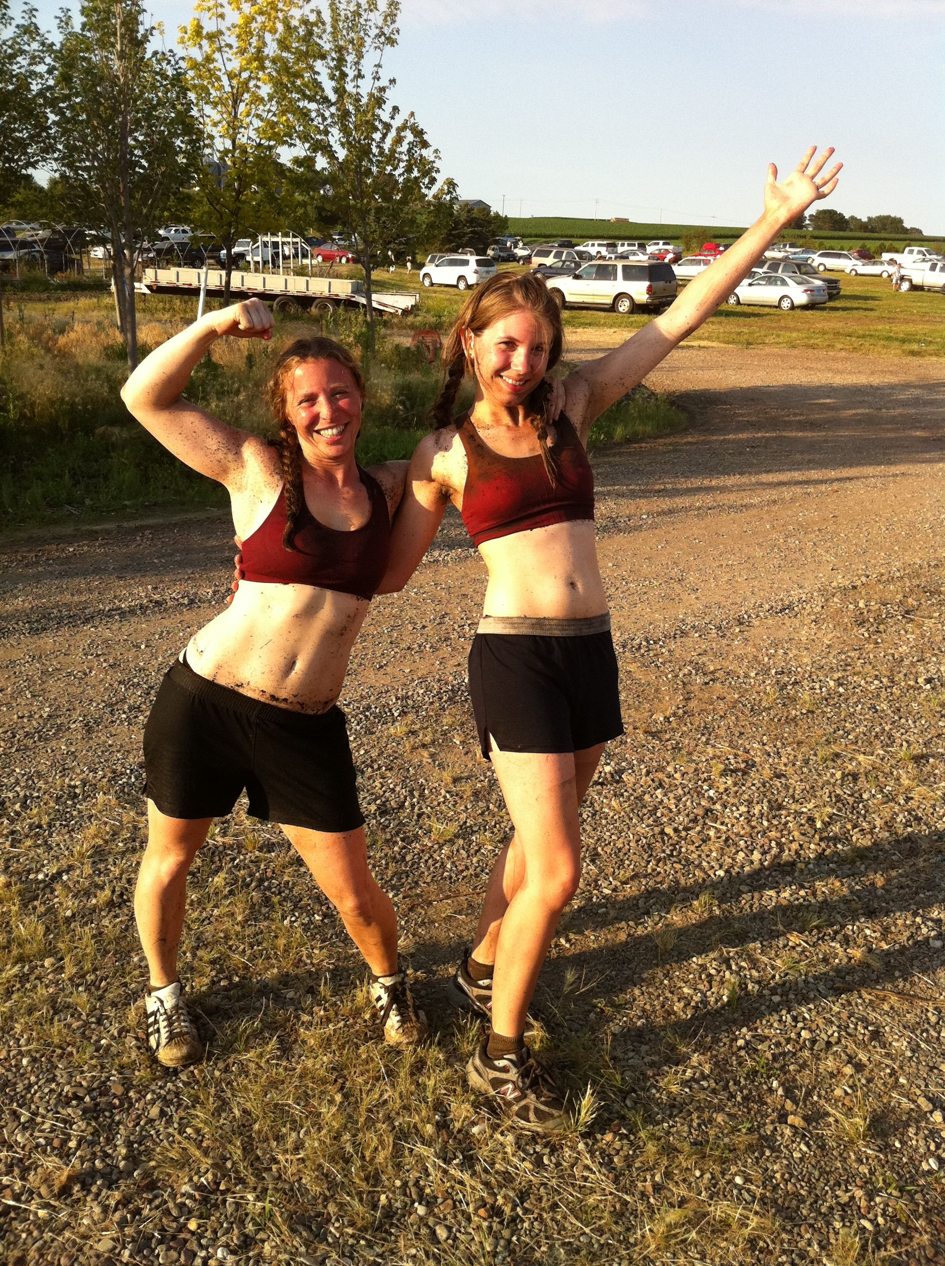 Angie & I show off our slightly less muddy muscles......we rocked the Warrior Dash at Afton Alps June 2012 :D