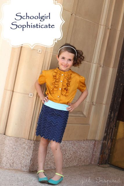 love the gold blouse with navy blue chevron skirt
