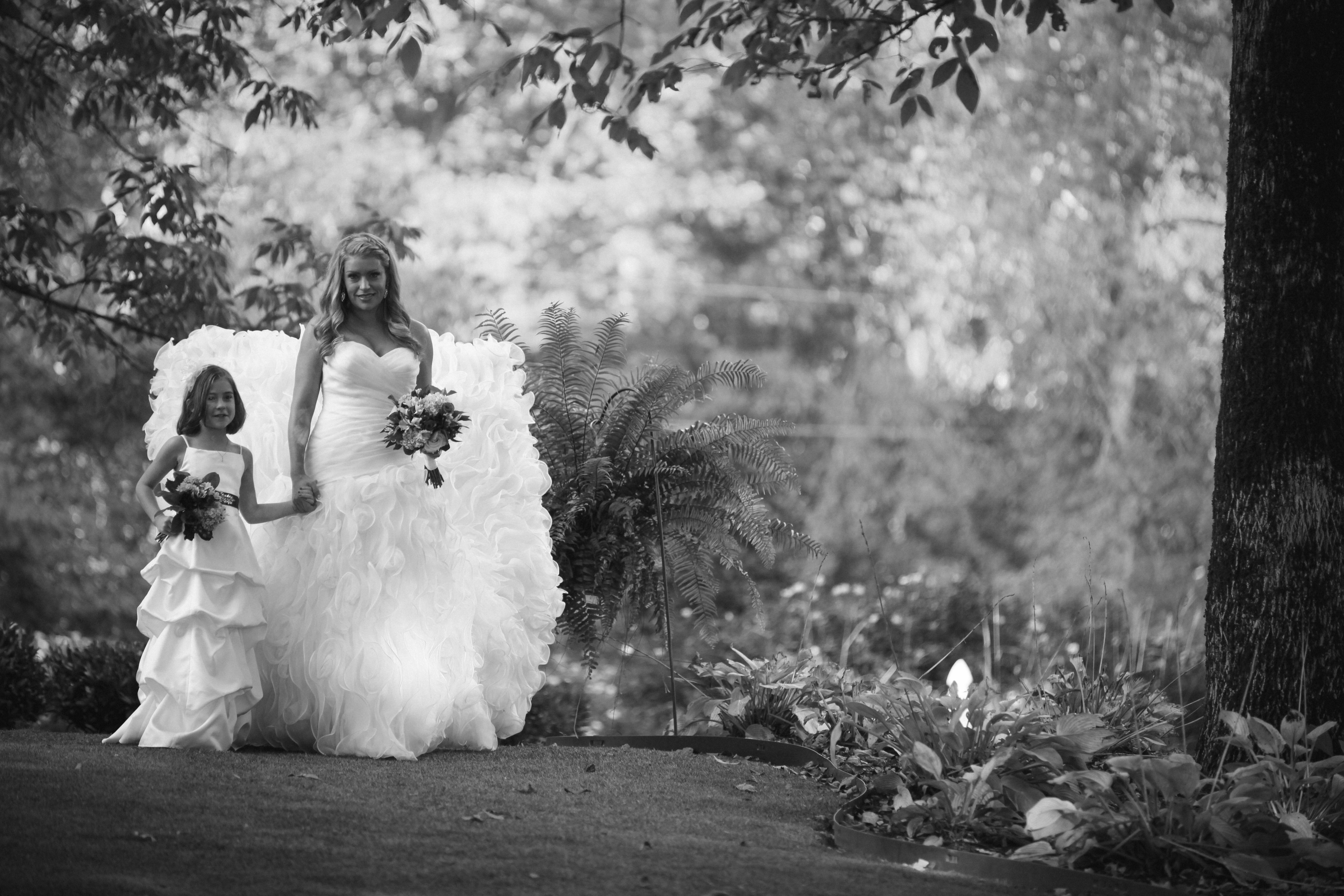 Coming down the aisle. Wedding planner fixing a bride