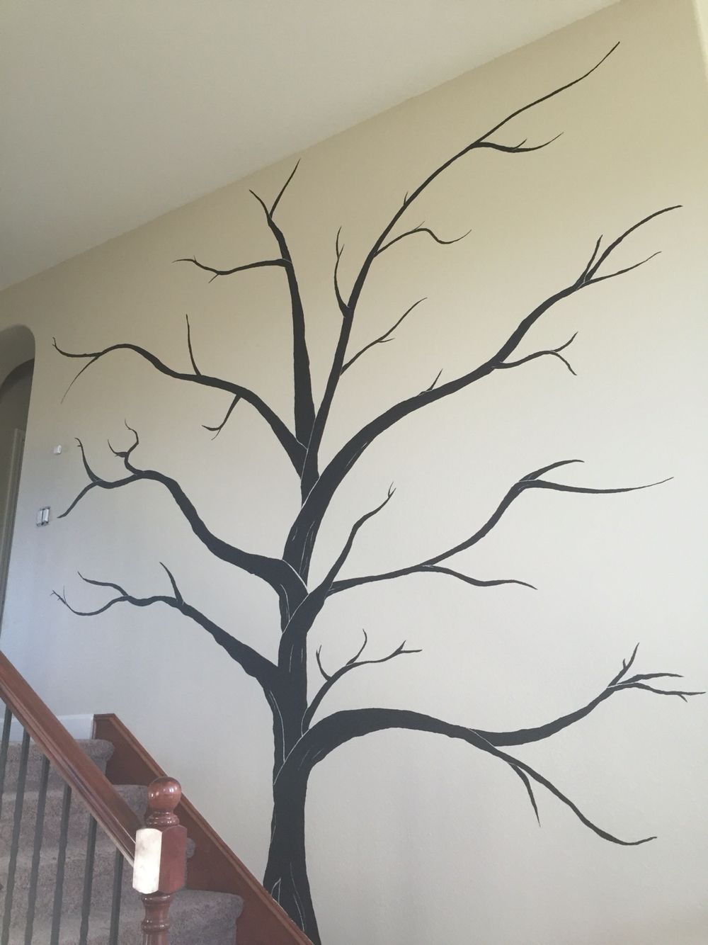 We painted this huge tree on our wall going up the stairs. We plan ...