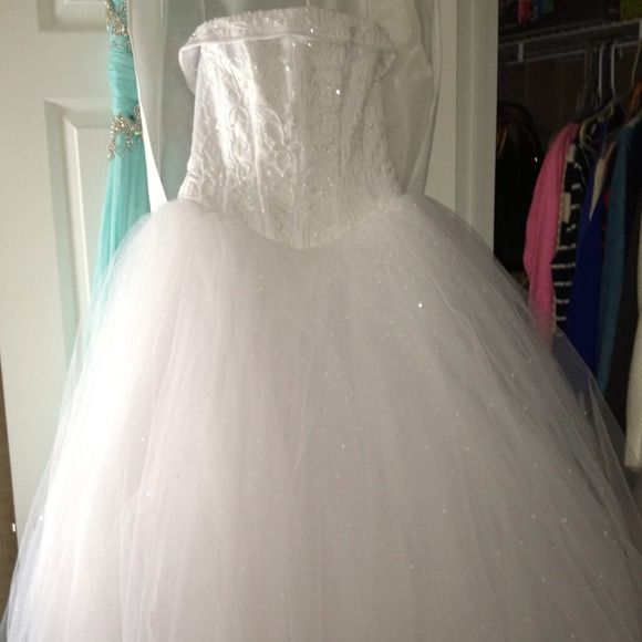 Michael Angelo wedding dress It's a size two, fits like a 2/4. I only wore it one time, it's in perfect condition! Great dress! Michael Angelo  Dresses