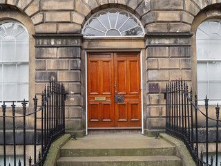 Front door of old stone townhouse