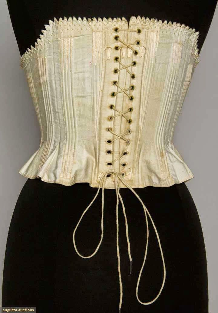 EMBROIDERED COTTON CORSET, 1855-1865       Mid 19th C short corset: white cotton, cane or baleen channel boning, hand embroidered c...