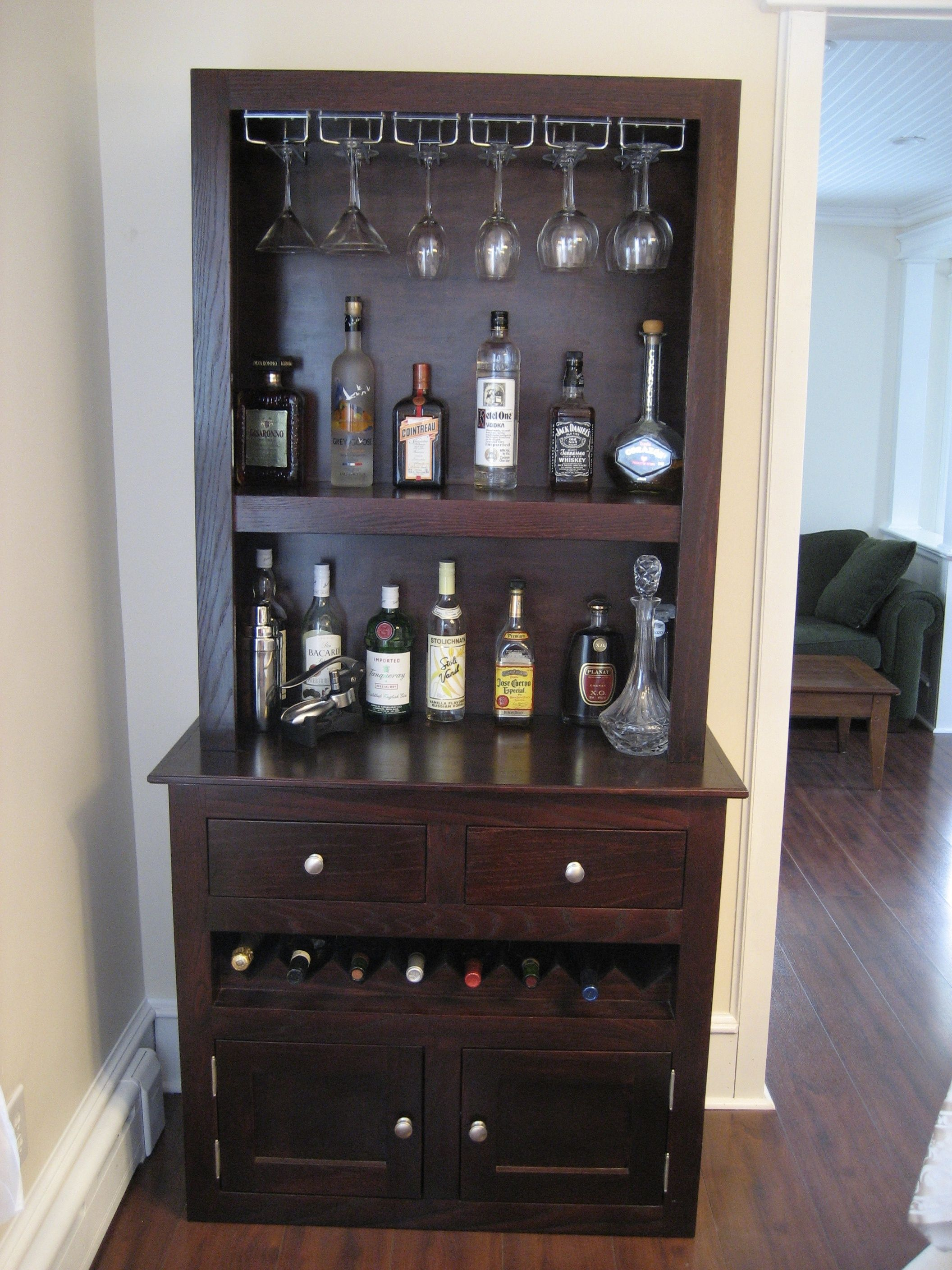 Custom liquor cabinet with glass racks, open shelving, integrated ...