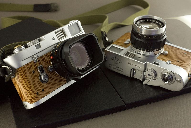 M4 + M2 | 1968 M4 w/ Leica Elmarit 28mm 2.8f asph lens, homemade soft-release and lizard-skin cover by 'Leica Leather'.   1663 M2 w/ Chiyoda 50mm 1.8f ltm lens, no-name soft-release and lizard-skin cover by 'Leica Leather'.