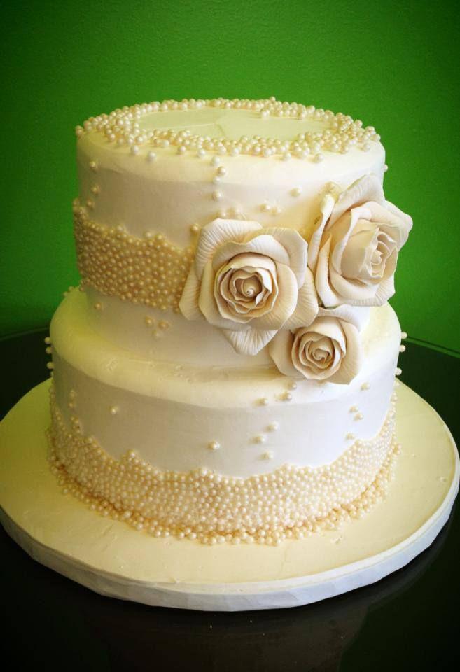 To have a beautiful cake on a small budget, use a small cake, like ...