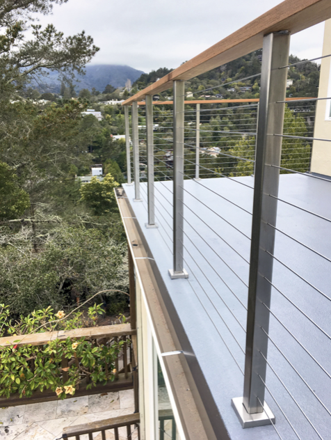 Our stainless steel posts complement the concrete surface ...