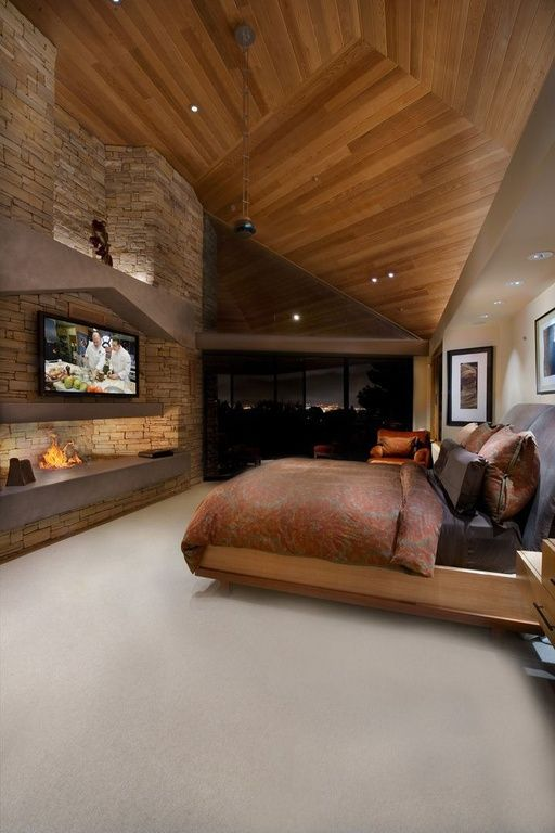 This Master Bedroom Features A Natural Wood Ceiling A Stone Fireplace And Access To A Private Patio Source Ht Home Luxurious Bedrooms Master Bedroom Design