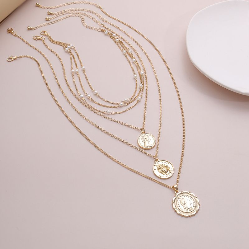 Photo of Vintage Embossed Coin Pendants Pearl Layer Necklace