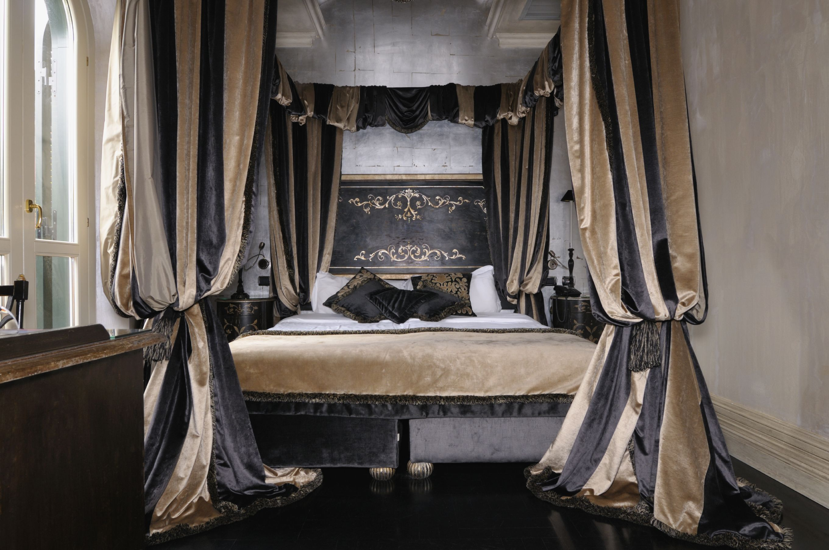 A king bed with striped taffeta curtains bishop sleeved up at the middle bedroom ideas Royal purple master bedroom