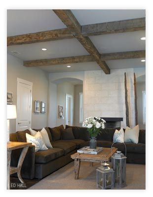 wooden ceiling beams and Brown L-shaped couch <3