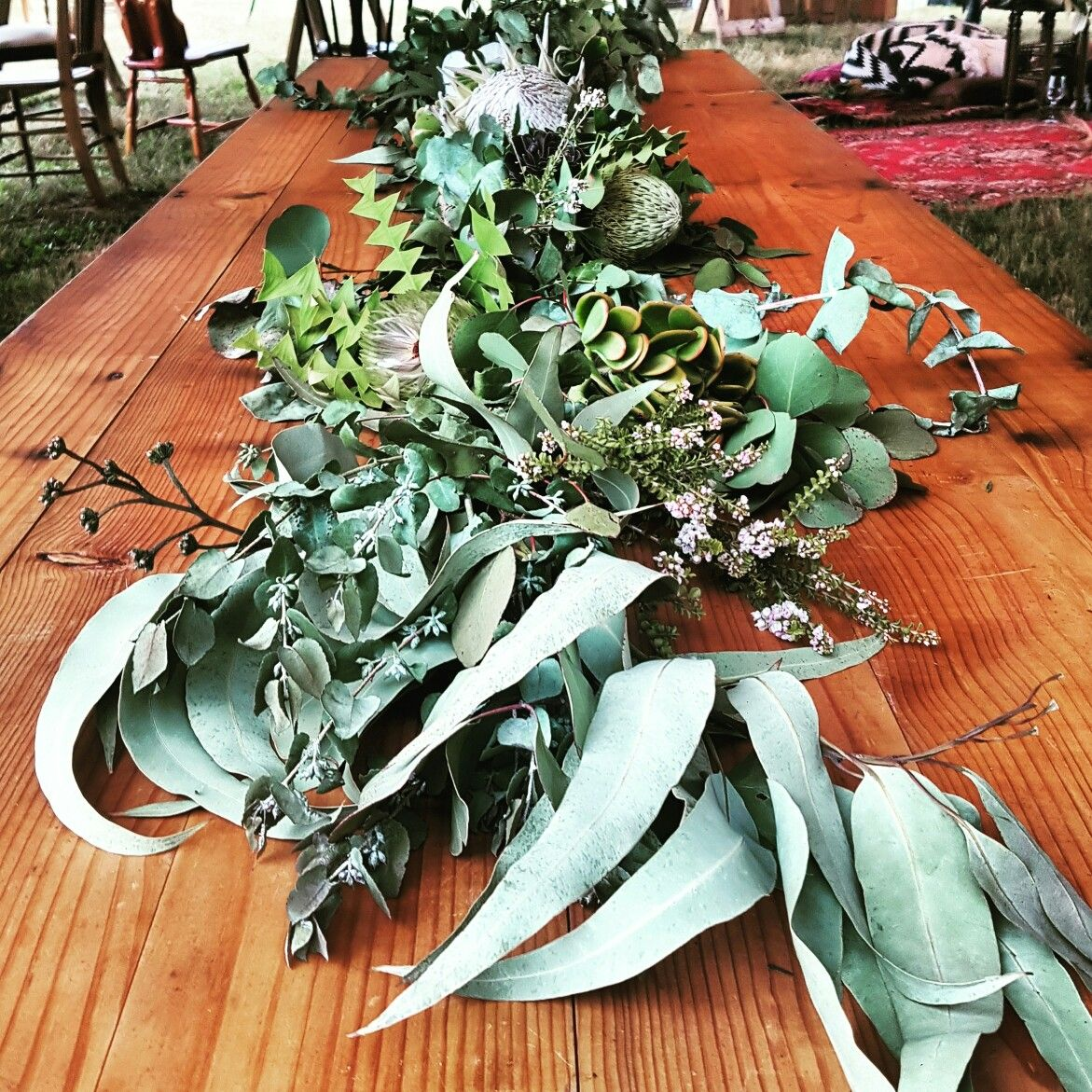 The beautiful Native table runner at Matilda and Shane's wedding in Bright, Vic. *swoon* and what a wonderful couple!!! ❤😍 #marriedAF #wedding #weddinginspiration #weddingflowers #flowerarrangement #native #australia #nature #melbournebride #rustic #stretchtent #romantic #eventhire #eventstyling #stretched_events #floral #foliage #bohemian #boho #bride #bridalinspo  #love #newlyweds . . . Email us at Hello@stretchedevents.com