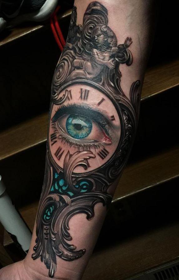 Indomitable Arm Tattoo Inkstylemag Clock Tattoo Eye Tattoo Tattoo Designs Men