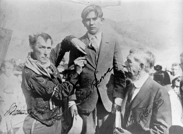Silent film star William S. Hart (L) & Presbyterian minister Wolcott Evans (R), both of Newhall, pin a hero's medal on Luis Rivera, son of saloon keeper Nick Rivera, following the St. Francis Dam disaster of March 12-13, 1928. The dam broke at three minutes before midnight on March 12th, sending a monumental 180-foot-high wall of water crashing down San Francisquito Canyon. It didn't stop until it reached the Pacific Ocean and left approximately 470 corpses in its wake.