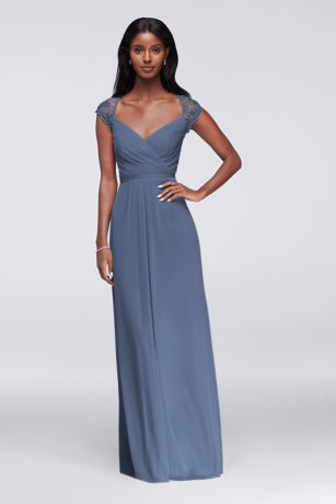 b3ebb4c04d59 The bodice of this long mesh bridesmaid dress is a thing of beauty: It  features a faux surplice front, lace cap sleeves, and a dramatic keyhole  back.