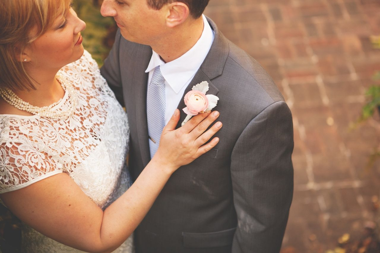 Love this peach #ranunculus boutonniere. A beautiful shot by Render Photography http://renderphotography.com/ Minneapolis.