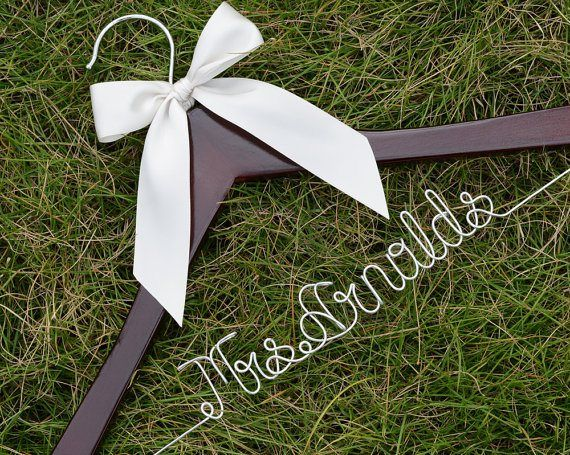 Personalised wedding hanger - see more ideas at http://themerrybride.org/2014/09/06/ideas-for-personalising-your-wedding/