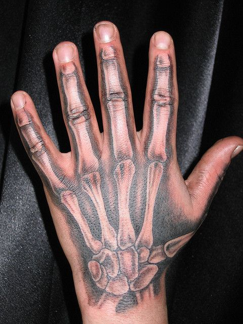 Urban Dictionary: skeleton hand holding a flower tattoo