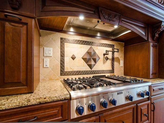 Backsplash Idea Combining Travertine Oil Rubbed Bronze Tiles