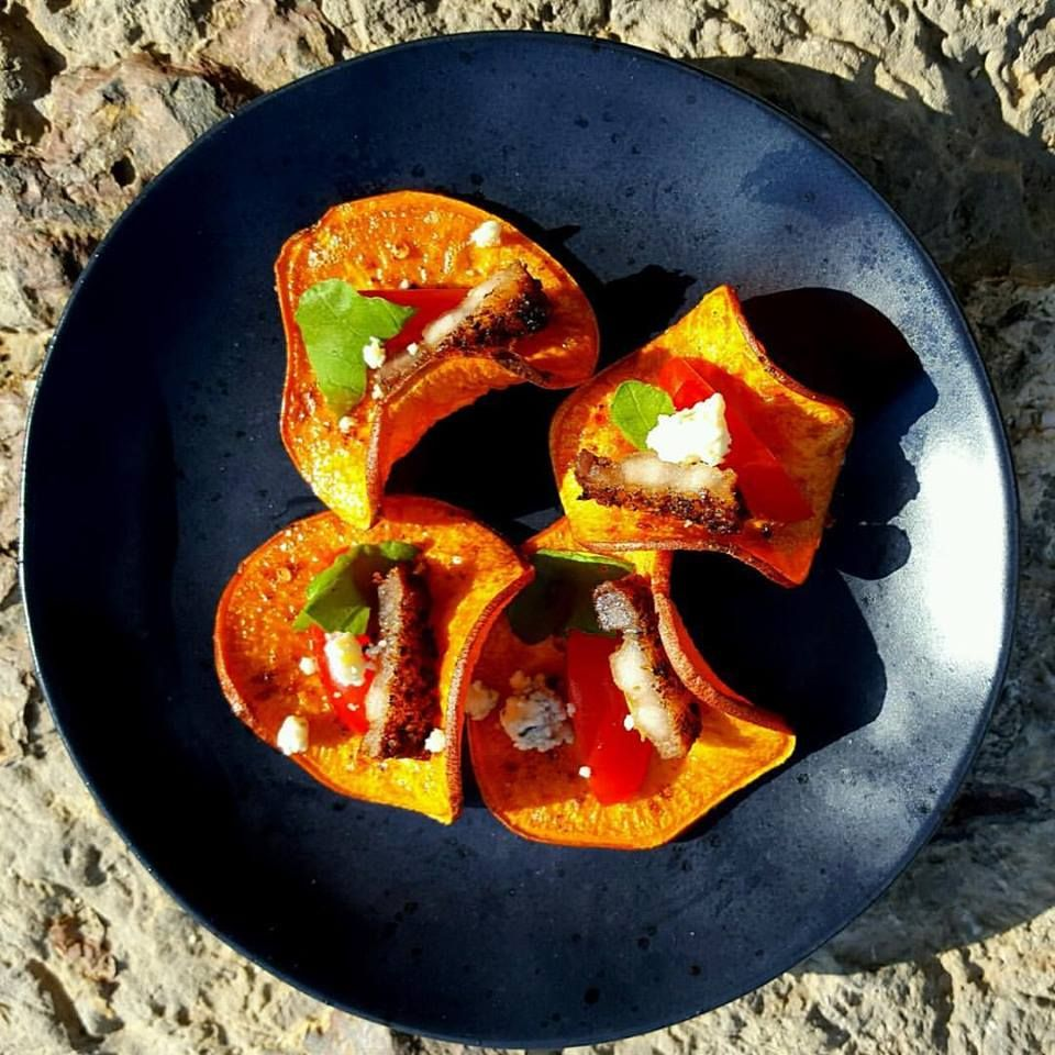 Sweet potato chips fried in bacon fat, our Berberé, bacon, blue cheese, grape tomato!