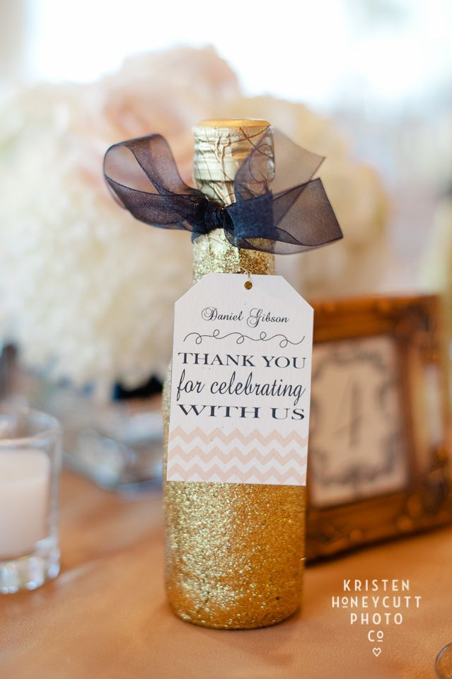 Mini bottles of champagne favors which double as place markers for the reception #wedding #weddingfavors #gold #goldwedding #champagne