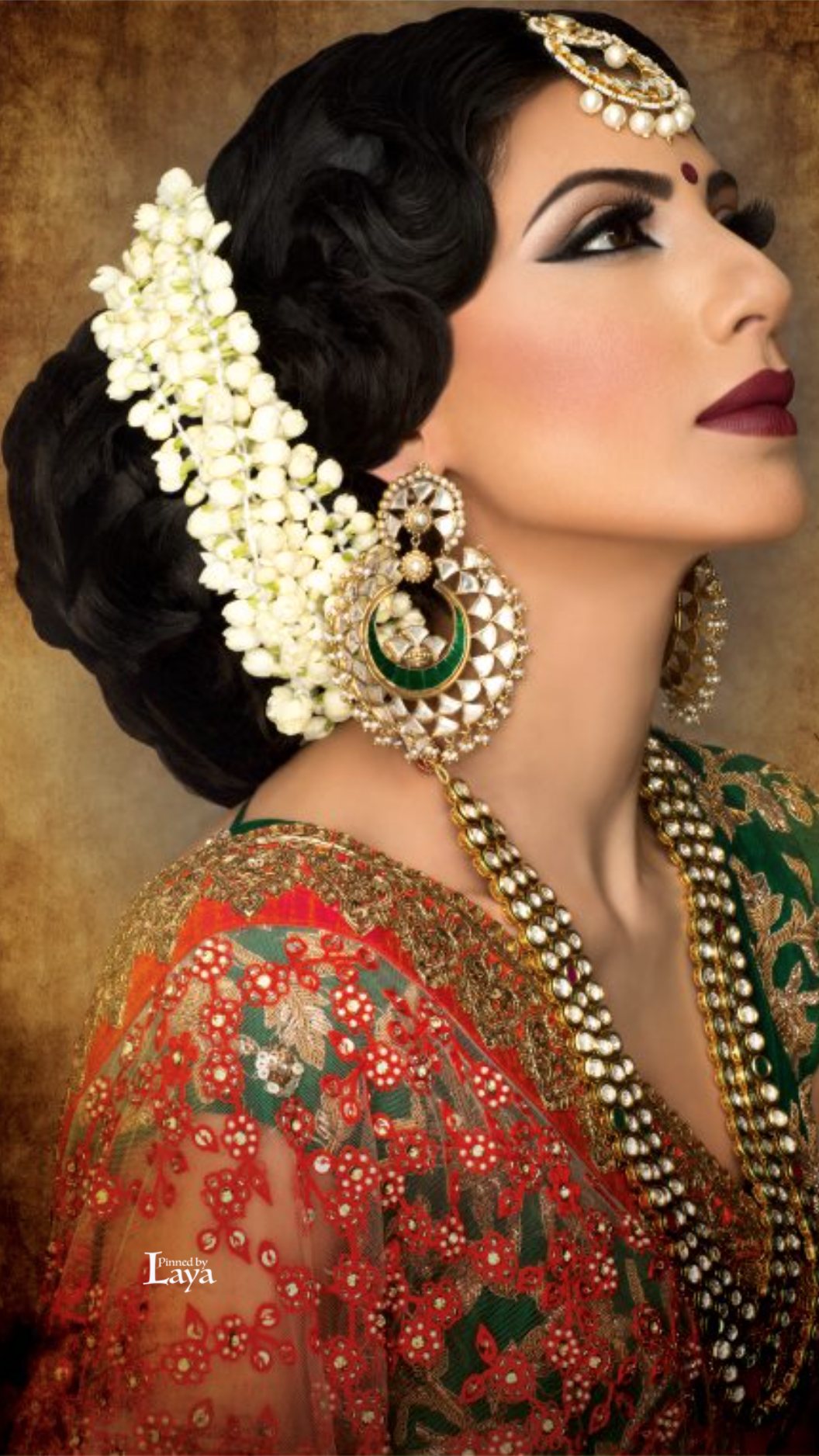 what a beautiful large low bun with real flower gajra! care