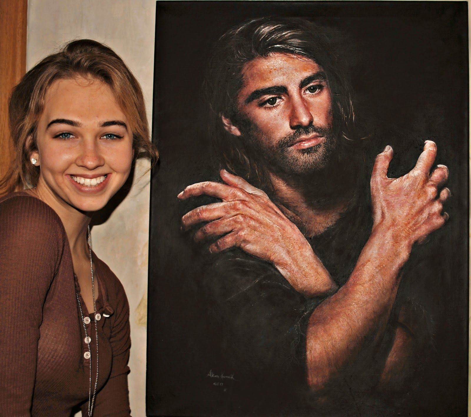 """Akiane age 17 with her original painting called """"I am"""