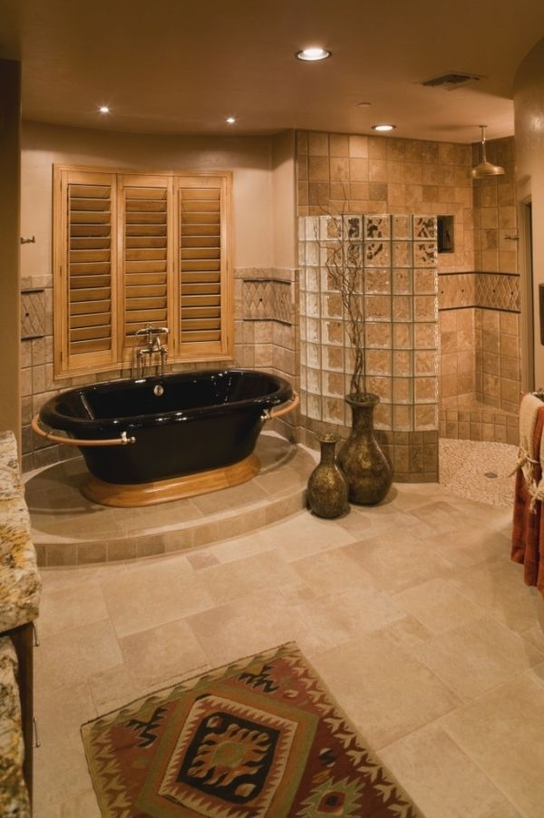 A walk in shower with no door to clean and a deep bath tub! by Eva
