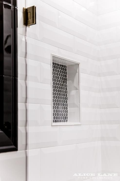 Seamless Glass Walk In Shower Boasts White Beveled Shower Tiles Framing A Black Hex Tiled Shower Nich Beveled Subway Tile Shower Shower Niche Tile Shower Niche