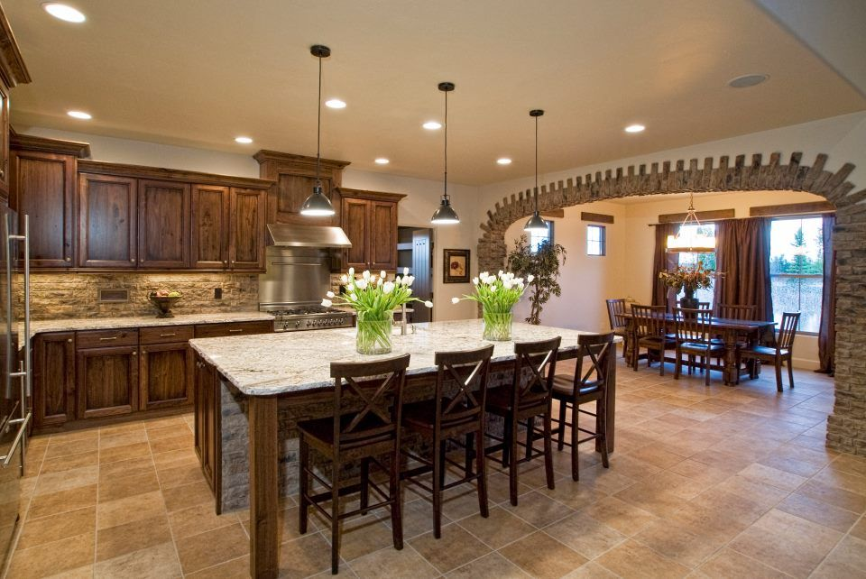 thin brick was used to beautify this kitchens archway and backsplash