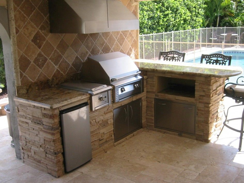 I like these colors also like the tiled backsplash with for Outdoor kitchen grill hood