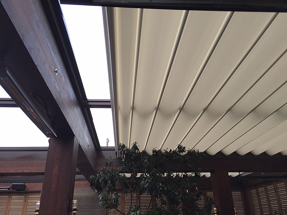 Retractable Fabric Canopy Systems Horizontal Roman Shades Slide On Track Canopies