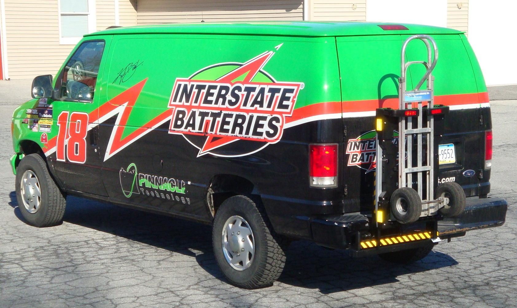 Interstate Batteries Ford Commercial Cargo Van With Hts Systems Hts 20sfe Swing Mount Hand Truck Carrier Rack B P Liberator Battery Hand Truck Locked Safely A