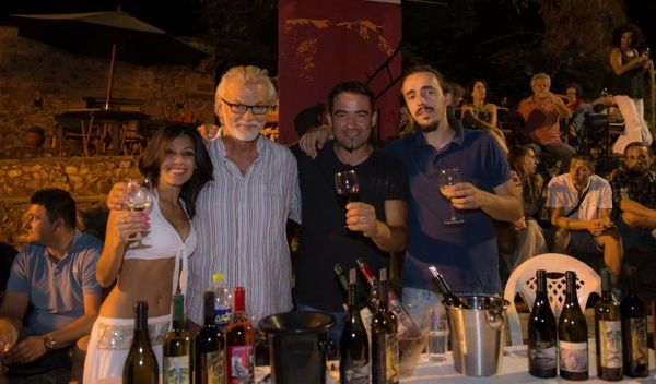 Winetasting in Litochoro. One of the sweetest girls in town Anastasia Polyxronidou to the left - and Apostolos Kourtis, the best winemaker in the region, second from right. Peter Krog