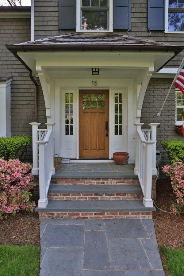 Main Entrance Tile Design Below Wooden Front Porch Posts On White
