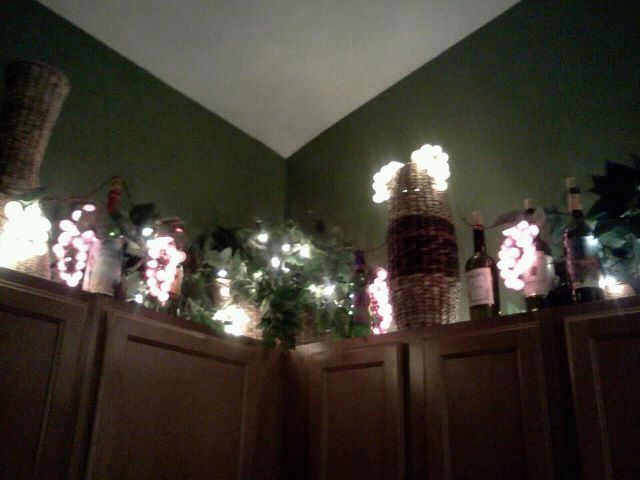 I Took Grape Lights And Empty Wine Bottles And Placed Them Above My Kitchen Along With