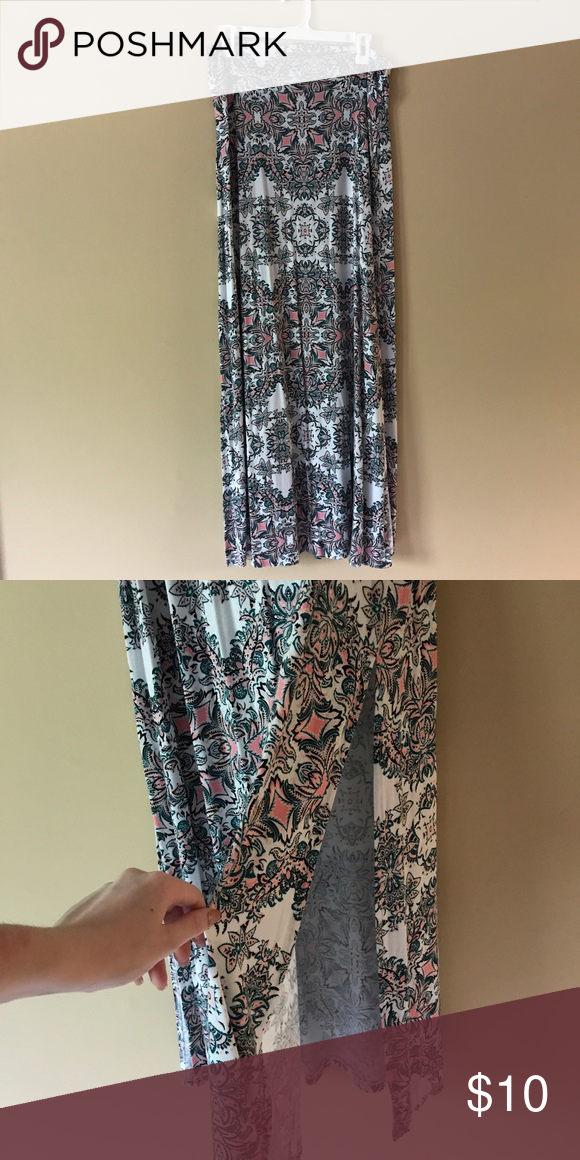 ✨OFFERS WELCOME✨Printed Maxi Skirt Printed Maxi Skirt from Charlotte Russe; only worn once; features green and light pink floral design throughout and high slits on both thighs; size large Charlotte Russe Skirts Maxi