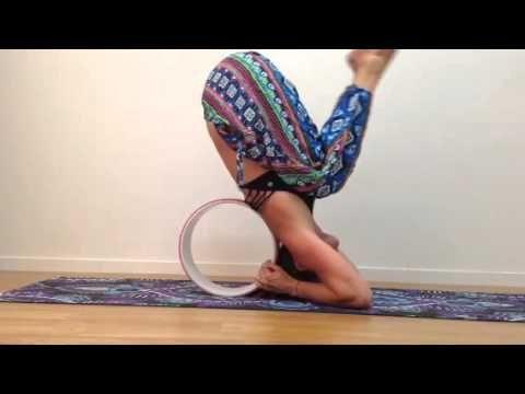 headstand with a prana wheel  youtube  yoga wheel