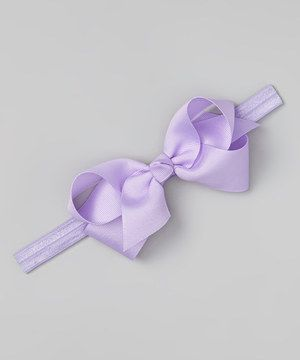 Add a beautiful bow to any petite sweet's ensemble with this darling headband. Boasting a charming hue, it pairs perfectly with a playful party dress or favorite tee.