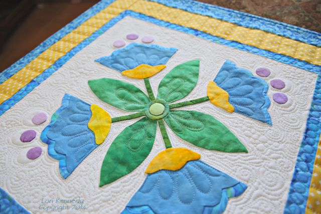 Eight steps to free motion quilting on applique applique