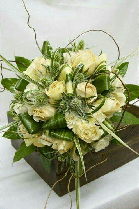 Ivory and green bouquet with roses, thistles, lily grasses and curly willows