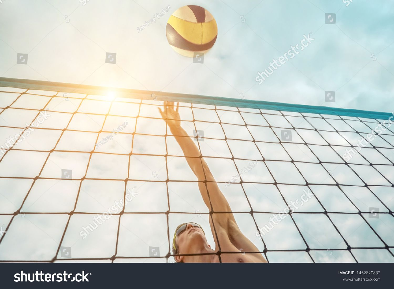Beach Volleyball Player In Sunglasses In Action With Ball Under Sunlight Popular Dynamic Outdoor Sport For In 2020 Volleyball Players Beach Volleyball Outdoor Sports